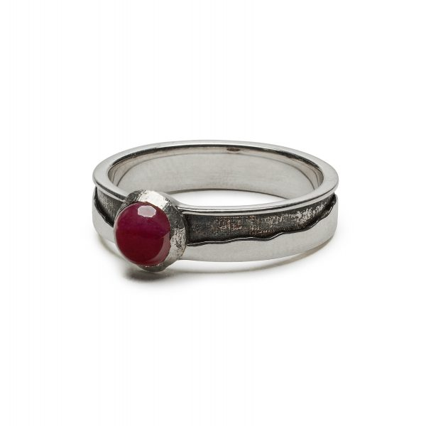 Sterling mountain ring set with ruby